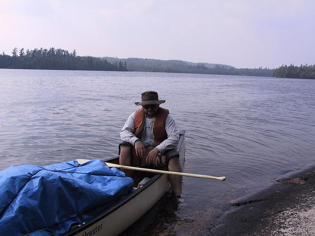 Pete about to get off the canoe and onto dry land